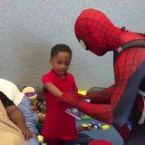Spider-Man cheering up kids